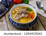 shurpa asian soup on wooden... | Shutterstock . vector #1396925042