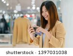 asian woman using credit card... | Shutterstock . vector #1397031038