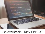Small photo of Computer code on laptop (web developing)