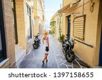 young traveling woman in hat... | Shutterstock . vector #1397158655