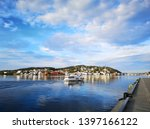 Transport boat in the Arendal city, Norway . In the summer and winter we can take the boat trip from the city other place on Arendal sea. Travel between city and island around. Comfortable and often.