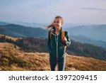 Portrait Of A Happy Woman Hike...