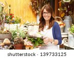 smiling mature woman florist... | Shutterstock . vector #139733125
