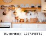 blurred kitchen background.... | Shutterstock . vector #1397345552