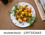 fried potatoes with mushrooms... | Shutterstock . vector #1397352665