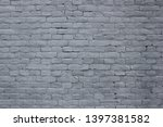light bluish grey brick wall...