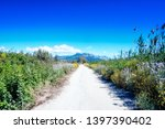 narrow mountain dirt road... | Shutterstock . vector #1397390402