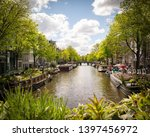 nice view at amsterdam canal... | Shutterstock . vector #1397456972