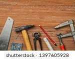 tools on a wooden background... | Shutterstock . vector #1397605928