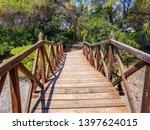 bridge built with logs in the... | Shutterstock . vector #1397624015