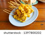 grilled pork satay served with... | Shutterstock . vector #1397800202