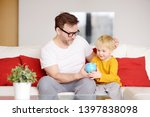 father and son putting coin... | Shutterstock . vector #1397838098