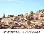 cairns  made by travelers in... | Shutterstock . vector #1397970665
