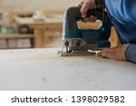 experienced male worker in a... | Shutterstock . vector #1398029582