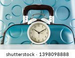 alarm clock and suitcases close ... | Shutterstock . vector #1398098888