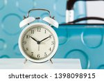 alarm clock close up at baggage ... | Shutterstock . vector #1398098915