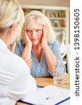 doctor or nursing consoling... | Shutterstock . vector #1398150605