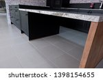 Stock photo beautiful quartz stone worktop for wooden kitchen design 1398154655