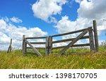 Wooden Gate In The Field ...