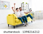 excited father and son cheering ... | Shutterstock . vector #1398216212