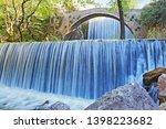 double waterfalls of... | Shutterstock . vector #1398223682