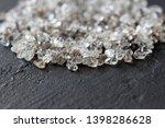 scattered diamonds on a black... | Shutterstock . vector #1398286628