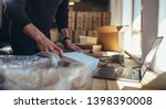 Small Business Owner Packing I...