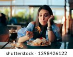 Woman Feeling Sick While Eatin...