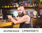 guy spend leisure in bar with... | Shutterstock . vector #1398450872