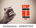 human hand crushing cigarette... | Shutterstock . vector #1398457265