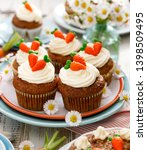 carrot cupcakes with mascarpone ... | Shutterstock . vector #1398509495