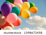 A large bunch of yellow helium...