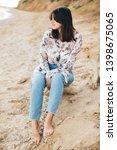stylish hipster girl sitting on ... | Shutterstock . vector #1398675065