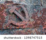 Small photo of Rusted symbols of the Soviet Union. Hammer and sickle.