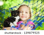 Stock photo girl lies in a hammock 139879525