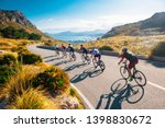 Small photo of Team sport cyclist photo. Group of triathlete on bicycle ride on the road at Mallorca, Majorca, Spain.