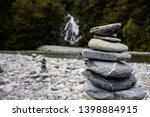 stone mohyla with waterfall in... | Shutterstock . vector #1398884915