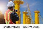 engineer hand holding radio...   Shutterstock . vector #1398957038