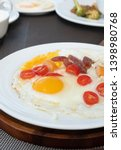 side view of fried eggs serve... | Shutterstock . vector #1398980768