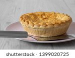 steak and ale pie cooked on a... | Shutterstock . vector #1399020725