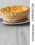 steak and ale pie cooked on a... | Shutterstock . vector #1399020728