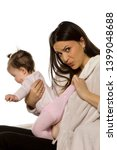 a young mother checks her baby... | Shutterstock . vector #1399048688