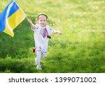 child carries fluttering blue... | Shutterstock . vector #1399071002
