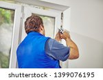 worker using silicone for walls ... | Shutterstock . vector #1399076195