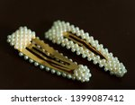 decorative hair clips on brown...   Shutterstock . vector #1399087412
