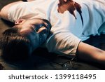 dead man with blood on t shirt... | Shutterstock . vector #1399118495