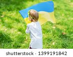 child carries fluttering blue... | Shutterstock . vector #1399191842