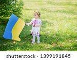 child carries fluttering blue... | Shutterstock . vector #1399191845