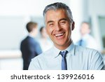 Mature Businessman With...