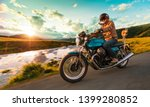 motorcycle driver riding in... | Shutterstock . vector #1399280852